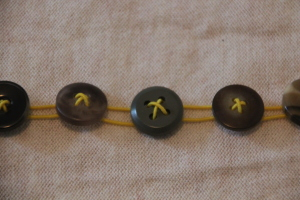 Button in bracelet